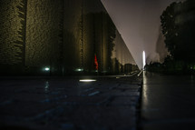 Vietnam Memorial with Washington Monument  in background, taken at night
