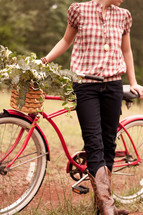 woman and a vintage bicycle