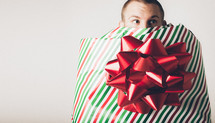 A man wrapped as a Christmas present