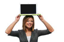 Woman holding a laptop computer on her head.