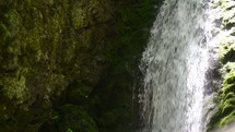 waterfall over mossy rock