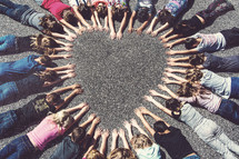 kids forming a heart shape with their hands