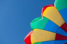 a rainbow colored parachute