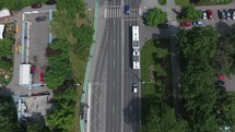 Aerial view with a bus stopping at the station in the city.