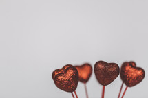 red glittery hearts on sticks