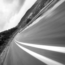 Asphalt blurred highway with double dividing line - traveling at fast speeds