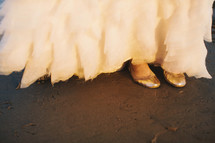 brides shoes under her bridal dress