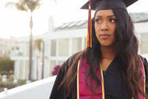 female African American graduate in cap and gown