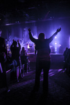 Woman in aisle at worship service