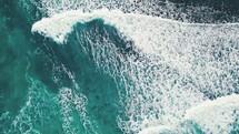 waves washing over kayakers