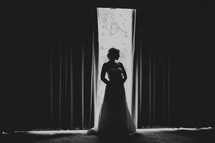 A profile of a bride and her dress