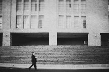 a man walking in front of a building