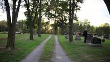 a man visiting a grave