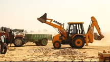 a bulldozer moving sand in a construction site