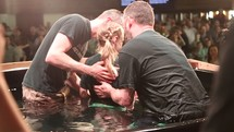 dunking baptism during a worship service