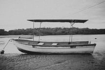 a boat docked in a river