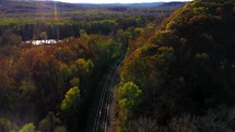 aerial view over train tracks in autumn