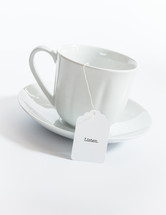 tea cup with a tea bag with the word listen