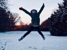 girl jumping in snow