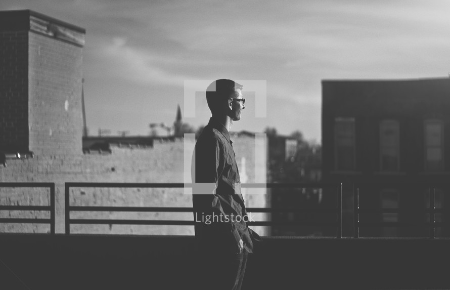 man looking out over a railing