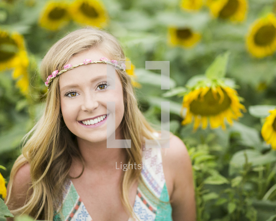 a teen girl in a field of sunflowers