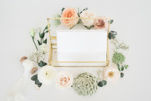 wedding ring and stationary in a glass box