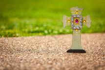 a decorative cross on a sidewalk