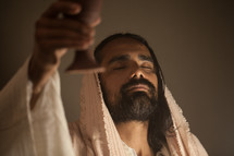 Jesus with a raised communion chalice