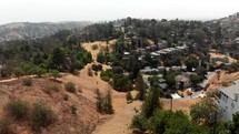 Aerial Shot Ascending and Flying Towards a Group of East Los Angeles Homes
