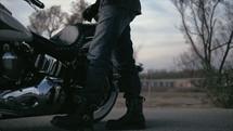 man getting on a Harley