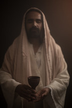 Jesus holding a chalice at the Last Supper