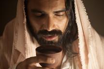 Jesus holding a communion chalice