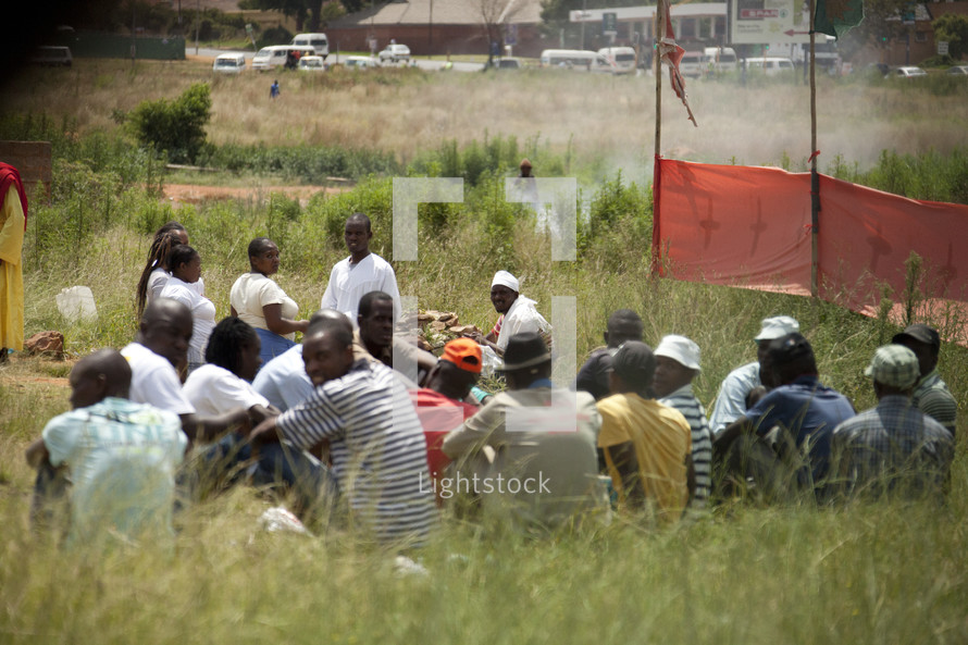 A cult group meets in a field in South Africa