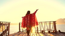a woman dancing on a dock