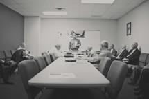 elderly men sitting in a classroom for Sunday School