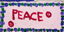 A finger painting with peace and peace signs.