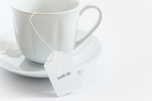tea cup with a tea bag with the word look up