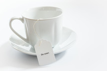 tea cup with a tea bag with the word be near