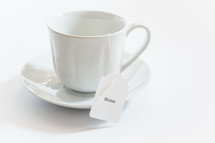 tea cup with a tea bag with the word home