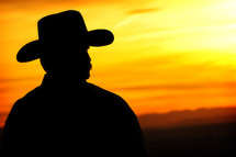 silhouette of a cowboy at sunset