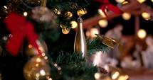 Jesus Christ Nativity scene with atmospheric lights near Christmas tree. Christmas scene. Dolly shot 4k