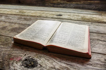 open Bible on wood boards