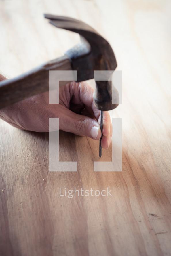 hammer a nail