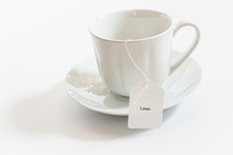 tea cup with a tea bag with the word leap