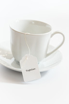 tea cup with a tea bag with the word together