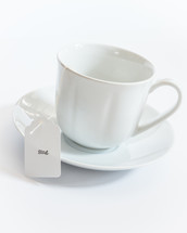 tea cup with a tea bag with the word sing