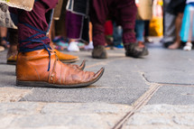 Close up view of  curved medieval shoes. Musician shoes