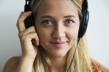 a teen girl listening to headphones