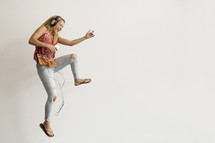 a teenage girl dancing to music