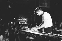 a man playing a digital keyboard on stage